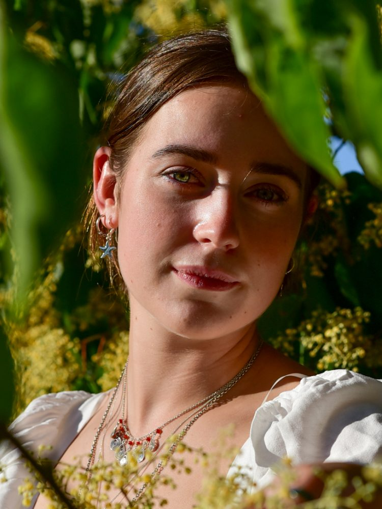 Photo of Zara, Circulus Jewellery owner at a summer day in Kew gardens featuring her jewellery products / photography by Bruna Balodis
