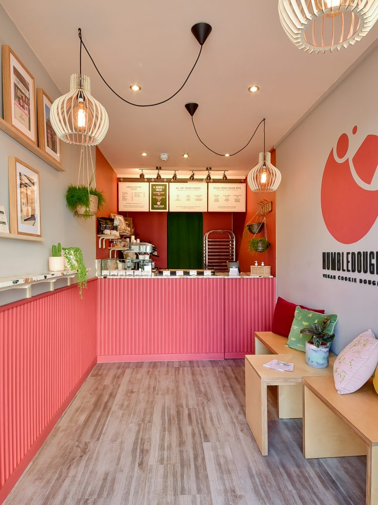 Photo of the interior design of a pink vegan cookie shop in box park containers in Shoreditch called the HumbleDough in London / Interior photo by Bruna Balodis photography